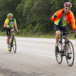 Cyclists weather storms to fight hunger